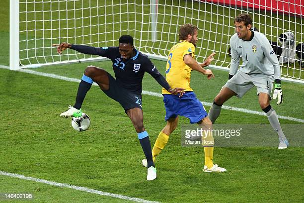 Danny Welbeck of England scores their third goal past Andreas Isaksson of Sweden during the UEFA EURO 2012 group D match between Sweden and England...