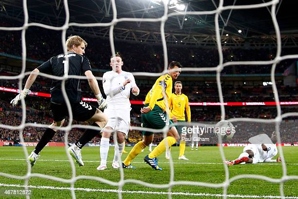 Danny Welbeck of England shot deflects off Tadas Kijanskas of Lithuania for Englands second goal during the EURO 2016 Qualifier match between England...