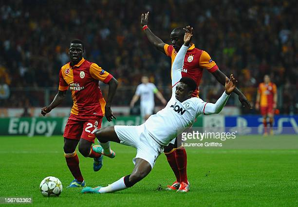 Danny Welbeck of Manchester United battles with Dany Nounkeu and Emmanuel Eboue of Galatasary during the UEFA Champions League Group H match between...