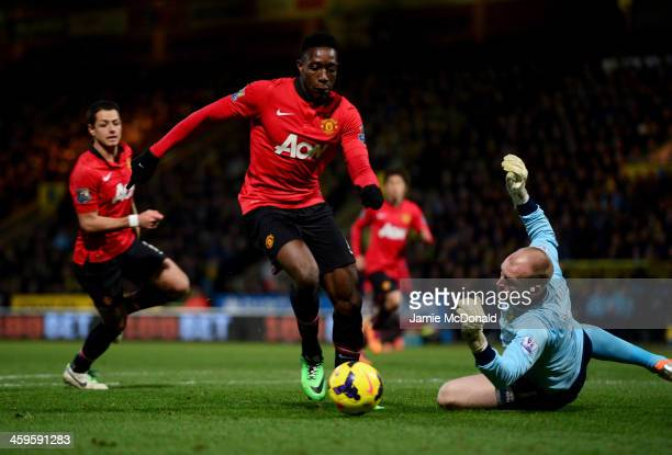 Danny Welbeck of Manchester United beats John Ruddy of Norwich City to score their first goal during the Barclays Premier League match between...