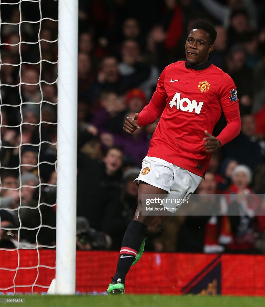 Danny Welbeck of Manchester United celebrates scoring their first goal during the Barclays Premier League match between Manchester United and Tottenham Hospur at Old Trafford on January 1, 2014 in Manchester, England.