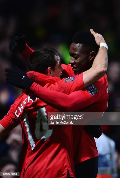 Danny Welbeck of Manchester United celebrates with Javier Hernandez as he scores their first goal during the Barclays Premier League match between...