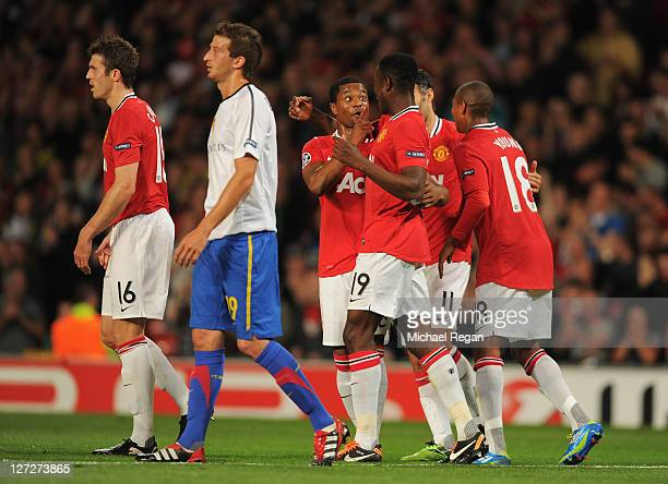 Danny Welbeck of Manchester United celebrates with Patrice Evra as he scores their second goal during the UEFA Champions League Group C match between...