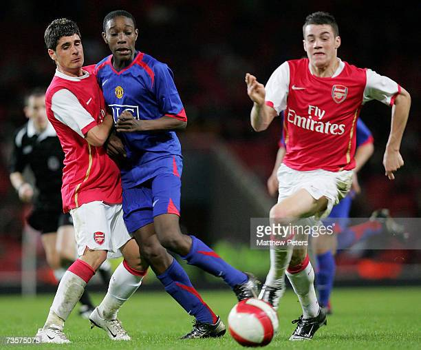 Danny Welbeck of Manchester United clashes with Francisco Merida and James Dunne of Arsenal during the FA Youth Cup semifinal first leg match between...