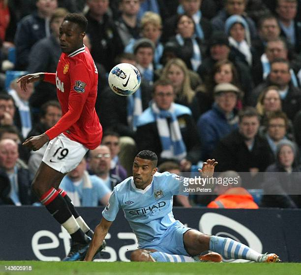 Danny Welbeck of Manchester United clashes with Gael Clichy of Manchester City during the Barclays Premier League match between Manchester City and...