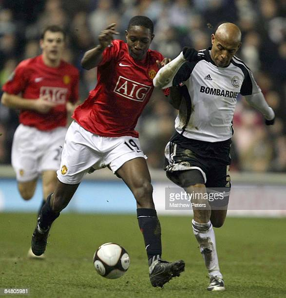 Danny Welbeck of Manchester United clashes with Jordan Stewart of Derby County during the FA Cup sponsored by eon Fifth Round match between Derby...