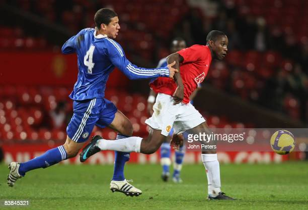 Danny Welbeck of Manchester United clashes with Rohan Ince of Chelsea during the FA Youth Cup Third Round match between Manchester United Academy and...
