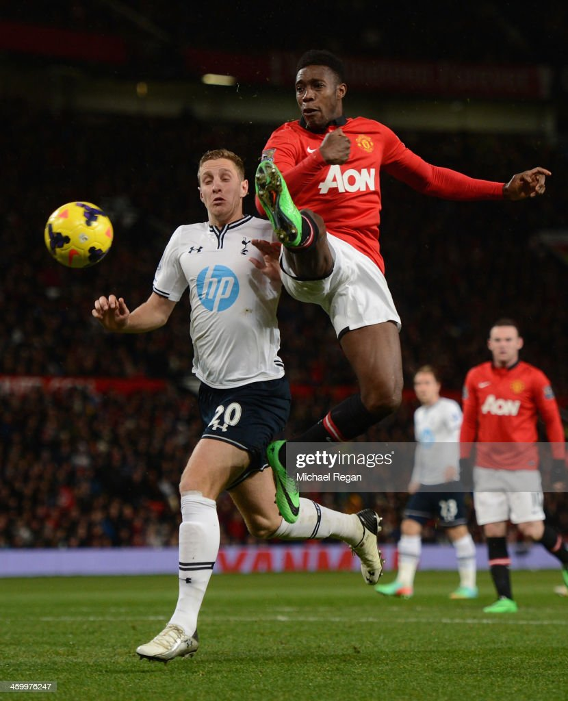 Danny Welbeck of Manchester United competes with Michael Dawson of Tottenham Hotspur during the Barclays Premier League match between Manchester United and Tottenham Hotspur at Old Trafford on January 1, 2014 in Manchester, England.