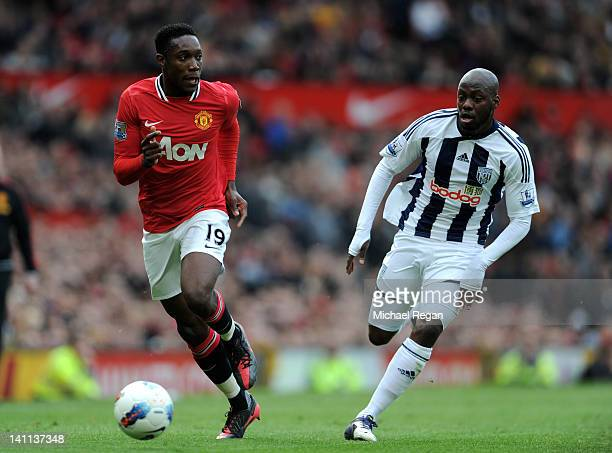 Danny Welbeck of Manchester United competes with Youssouf Mulumbu of West Bromwich Albion during the Barclays Premier League match between Manchester...