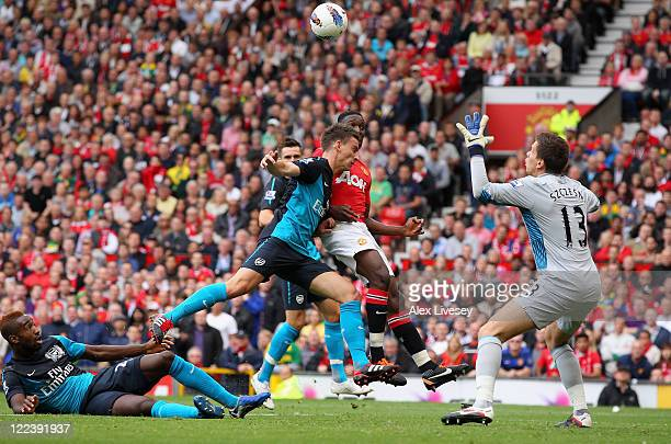Danny Welbeck of Manchester United gets in front of Laurent Koscielny of Arsenal and heads the ball past goalkeeper Wojciech Szczesny during the...