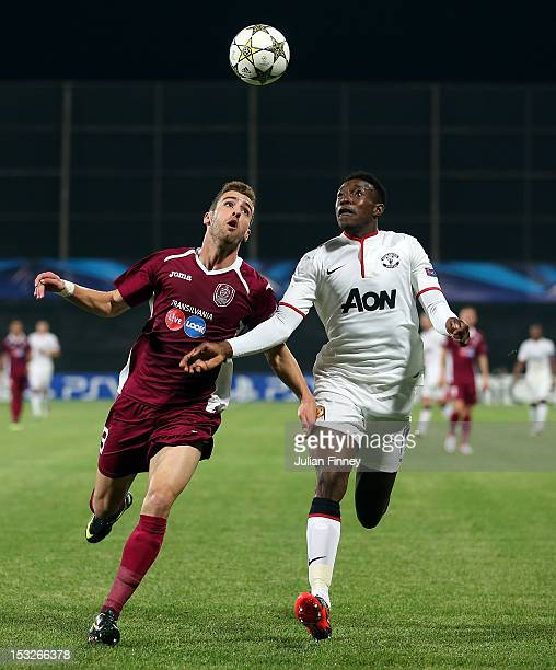 Danny Welbeck of Manchester United goes for the ball with Ivo Pinto of CFR 1907 Cluj during the UEFA Champions League Group H match between CFR 1907...