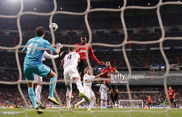 Danny Welbeck of Manchester United heads in the first goal during the UEFA Champions League Round of 16 first leg match between Real Madrid and...
