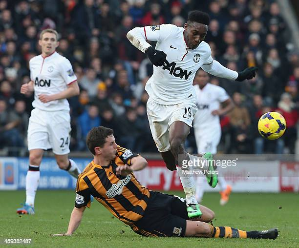 Danny Welbeck of Manchester United in action with Alex Bruce of Hull City during the Barclays Premier League match between Hull City and Manchester...