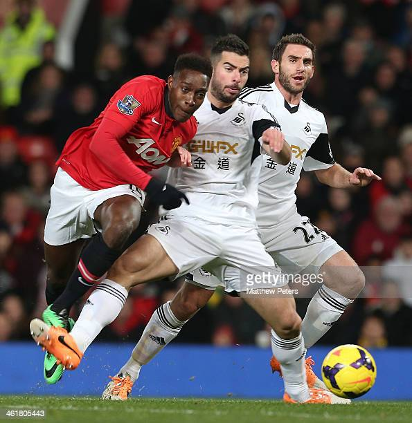 Danny Welbeck of Manchester United in action with Angel Rangel of Swansea City during the Barclays Premier League match between Manchester United and...