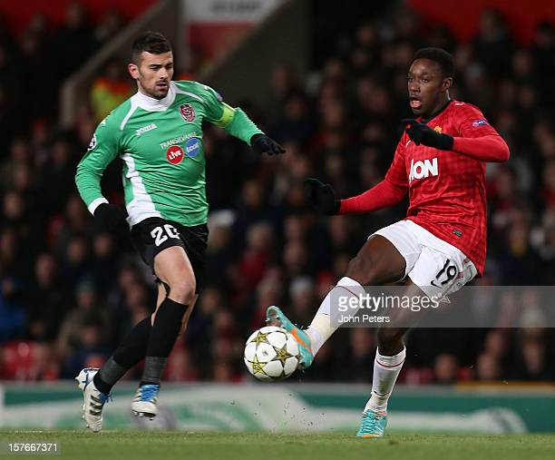 Danny Welbeck of Manchester United in action with Cadu of CFR 1907 Cluj during the UEFA Champions League Group H match between Manchester United and...