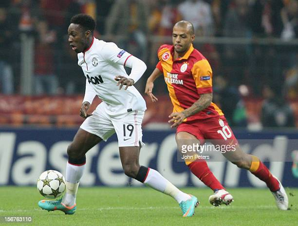 Danny Welbeck of Manchester United in action with Felipe Melo of Galatasaray AS during the UEFA Champions League Group H match between Galatasaray AS...