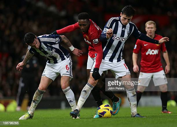Danny Welbeck of Manchester United in action with Liam Ridgewell and George Thorne of West Bromwich Albion during the Barclays Premier League match...