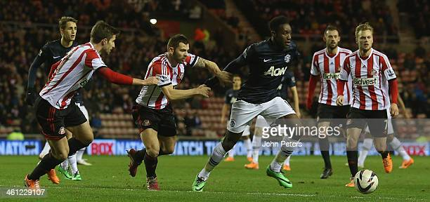 Danny Welbeck of Manchester United in action with Phil Bardsley of Sunderland during the Capital One Cup SemiFinal first leg between Sunderland and...