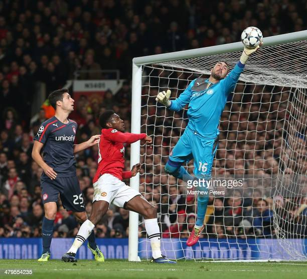 Danny Welbeck of Manchester United in action with Roberto of Olympiacos FC during the UEFA Champions League Round of 16 second leg match between...