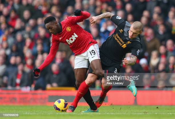 Danny Welbeck of Manchester United is challenged by Martin Skrtel of Liverpool during the Barclays Premier League match between Manchester United and...
