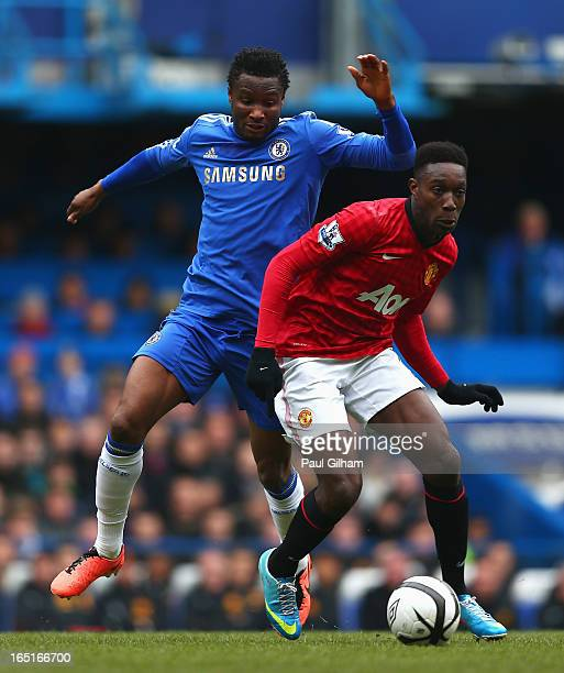 Danny Welbeck of Manchester United is challenged by Mikel of Chelsea during the FA Cup with Budweiser Sixth Round Replay match between Chelsea and...