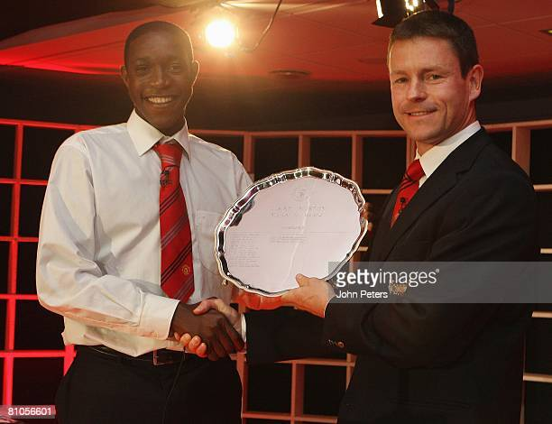 Danny Welbeck of Manchester United is presented with his Jimmy Murphy Academy Player of the Year award by Paul McGuinness during the annual...
