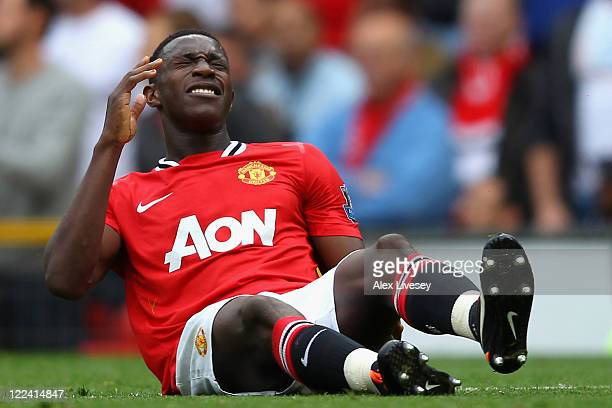 Danny Welbeck of Manchester United lies injured on the pitch during the Barclays Premier League match between Manchester United and Arsenal at Old...