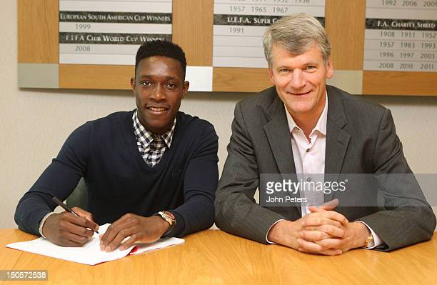 Danny Welbeck of Manchester United poses with Chief Executive David Gill after signing an extension to his contract with the club at Old Trafford on...