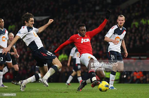Danny Welbeck of Manchester United scores the second goal ahead of a challenge from Sam Ricketts of Bolton Wanderers during the Barclays Premier...