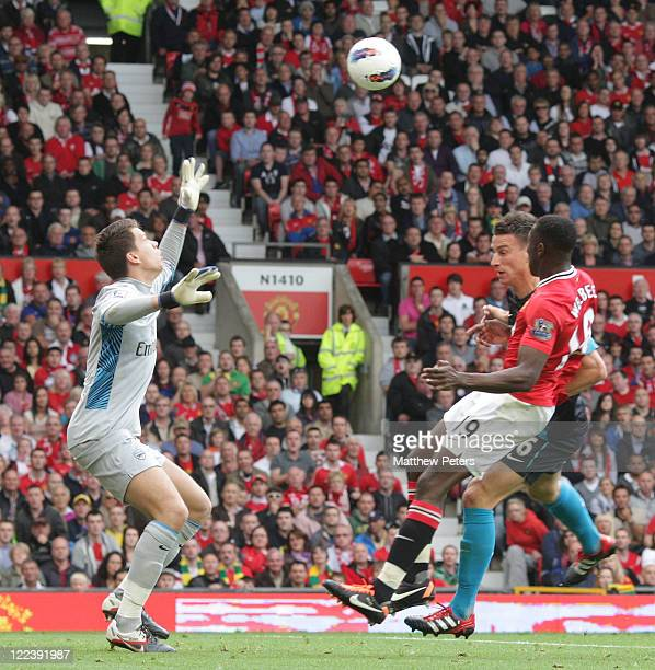 Danny Welbeck of Manchester United scores their first goal during the Barclays Premier League match between Manchester United and Arsenal at Old...