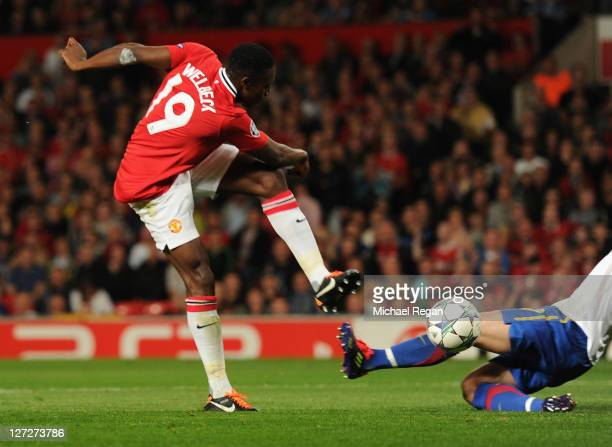 Danny Welbeck of Manchester United scores their first goal during the UEFA Champions League Group C match between Manchester United and FC Basel at...