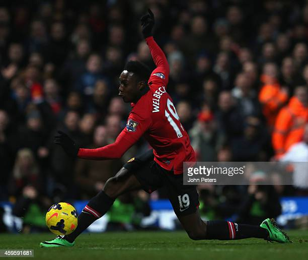 Danny Welbeck of Manchester United scores their first goal during the Barclays Premier League matche between Norwich City and Manchester United at...