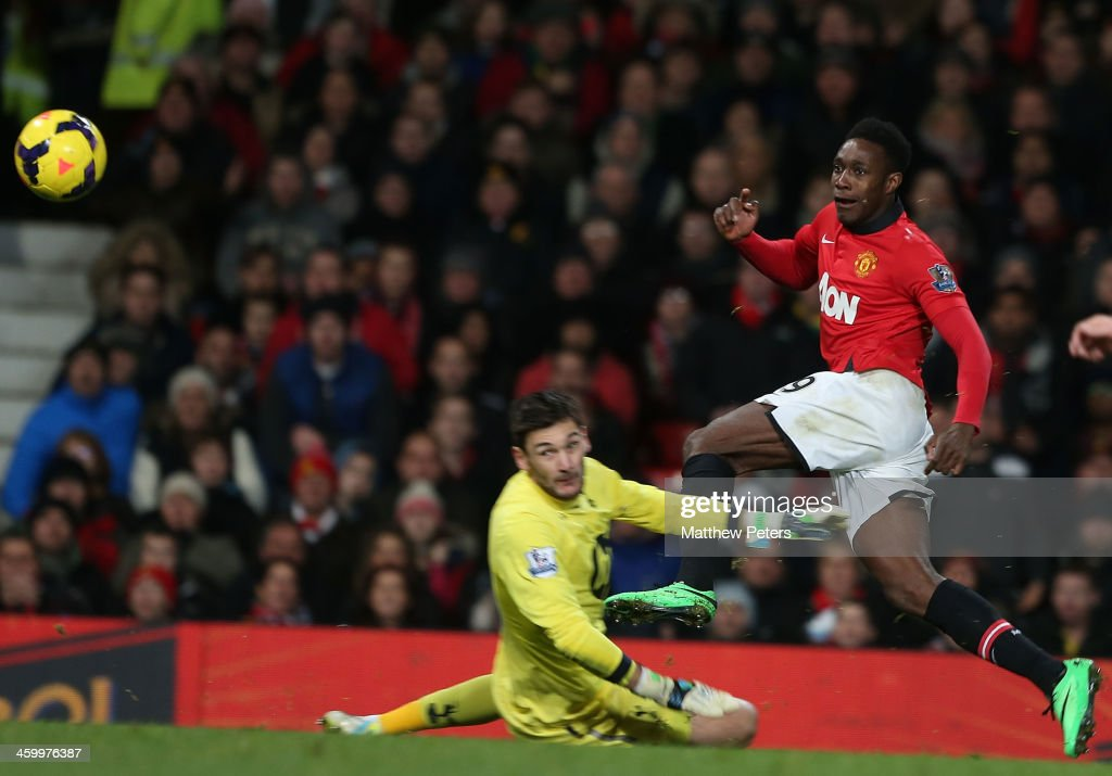 Danny Welbeck of Manchester United scores their first goal during the Barclays Premier League match between Manchester United and Tottenham Hospur at Old Trafford on January 1, 2014 in Manchester, England.