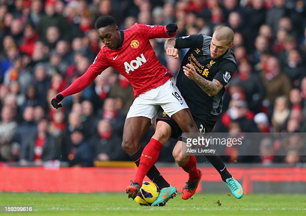 Danny Welbeck of Manchester United tangles with Martin Skrtel of Liverpool during the Barclays Premier League match between Manchester United and...
