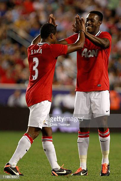 Danny Welbeck of the Manchester United celebrates his goal against the MLS AllStars with teammate Patrice Evra during the second half of the MLS...
