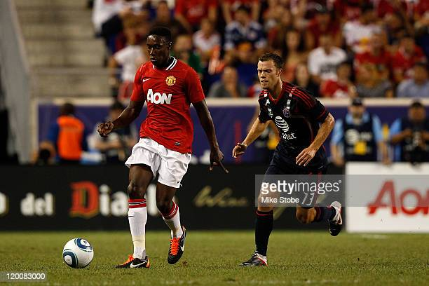 Danny Welbeck of the Manchester United controls the ball against Jack Jewsbury of the MLS AllStars during the MLS AllStar Game at Red Bull Arena on...