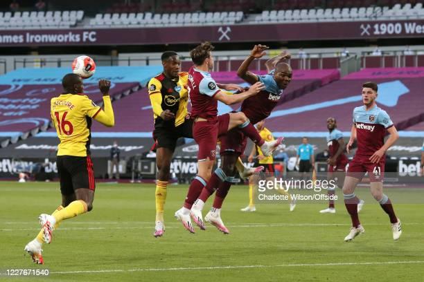 Danny Welbeck of Watford battles with Aaron Cresswell of West Ham and Angelo Ogbonna of West Ham during the Premier League match between West Ham...