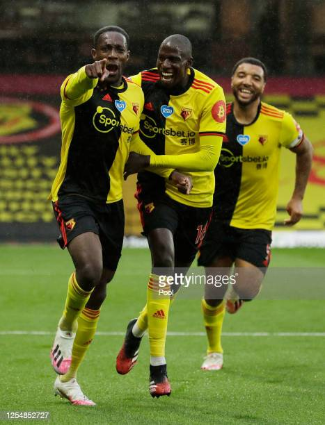 Danny Welbeck of Watford celebrates with teammate Abdoulaye Doucoure after scoring his team's second goal during the Premier League match between...