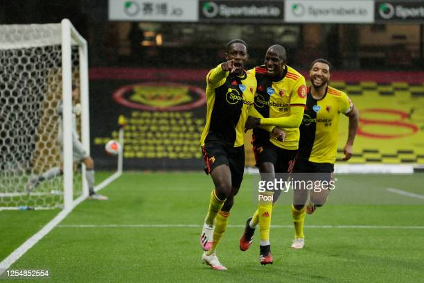Danny Welbeck of Watford celebrates with teammates Abdoulaye Doucoure and Troy Deeney after scoring his team's second goal during the Premier League...