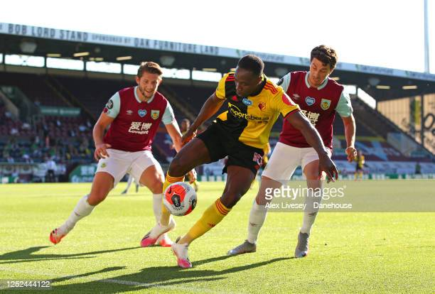 Danny Welbeck of Watford FC holds off Matthew Lowton and James Tarkowski of Burnley FC during the Premier League match between Burnley FC and Watford...