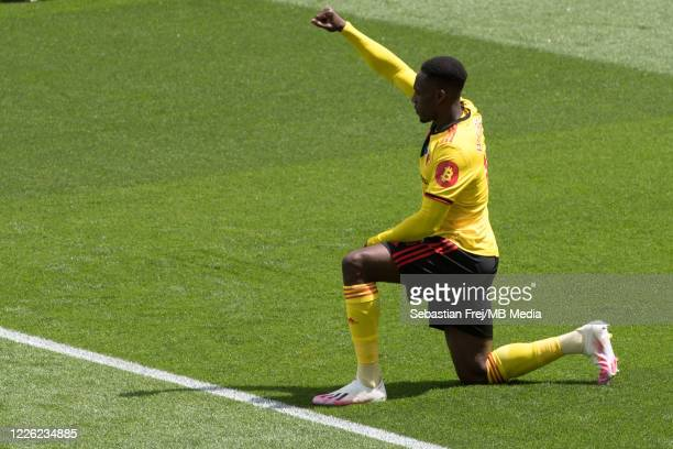 Danny Welbeck of Watford FC take a knee during the Premier League match between Watford FC and Newcastle United at Vicarage Road on July 11 2020 in...