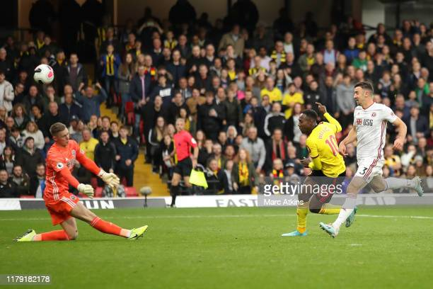 Danny Welbeck of Watford shoots as Dean Henderson of Sheffield United saves during the Premier League match between Watford FC and Sheffield United...