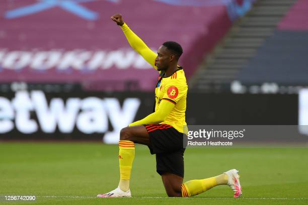 Danny Welbeck of Watford takes a knee in support of the Black Lives Matter movement during the Premier League match between West Ham United and...