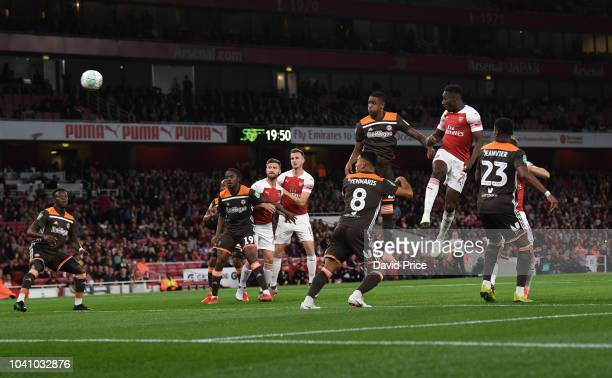 Danny Welbeck scores a goal for Arsenal during the Carabao Cup Third Round match between Arsenal and Brentford at Emirates Stadium on September 26...