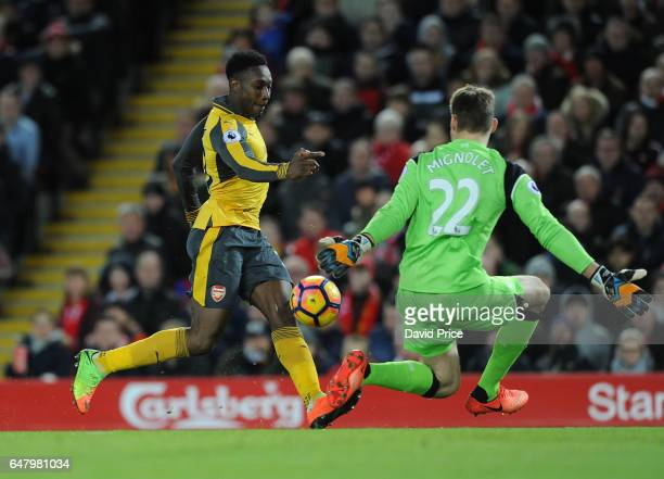 Danny Welbeck scores a goal for Arsenal past Simon Mignolet of Liverpool during the Premier League match between Liverpool and Arsenal at Anfield on...