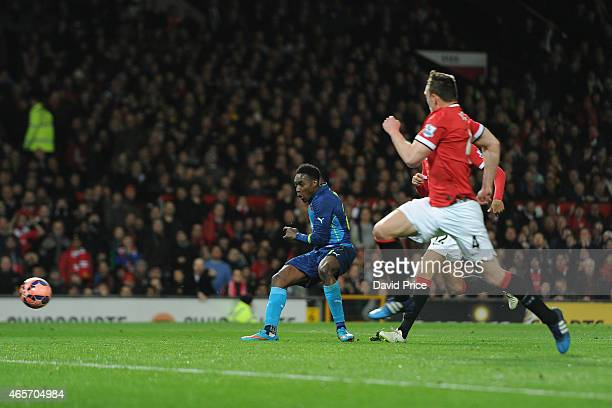 Danny Welbeck scores Arsenal's 2nd goal during the match between Manchester United and Arsenal in the FA Cup 6th Round at Old Trafford on March 9...
