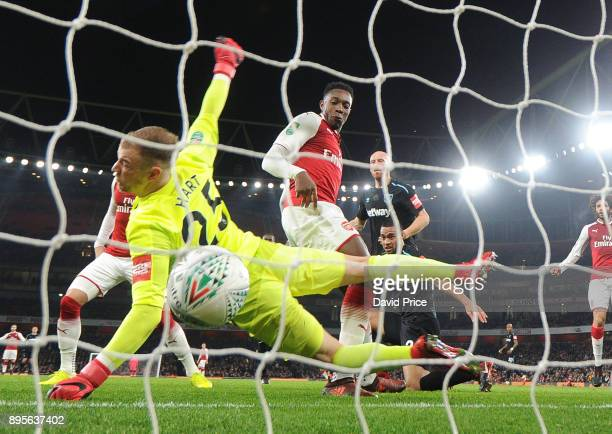 Danny Welbeck scores Arsenal's goal past Joe Hart of West Ham during the Carabao Cup Quarter Final match between Arsenal and West Ham United at...