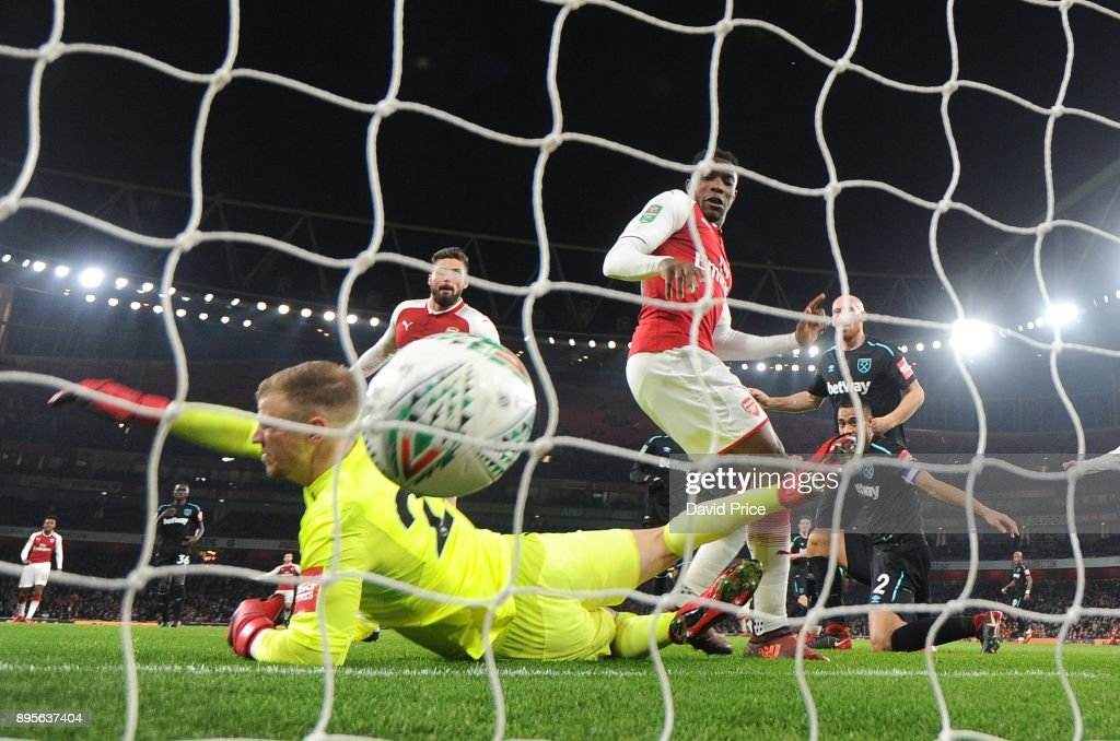 Danny Welbeck scores Arsenal's goal past Joe Hart of West Ham during the Carabao Cup Quarter Final match between Arsenal and West Ham United at Emirates Stadium on December 19, 2017 in London, England.