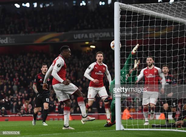 Danny Welbeck scores his 2nd goal Arsenal's 3rd past Gianluigi Donnarumma of Milan during the match between Arsenal and AC Milan at Emirates Stadium...