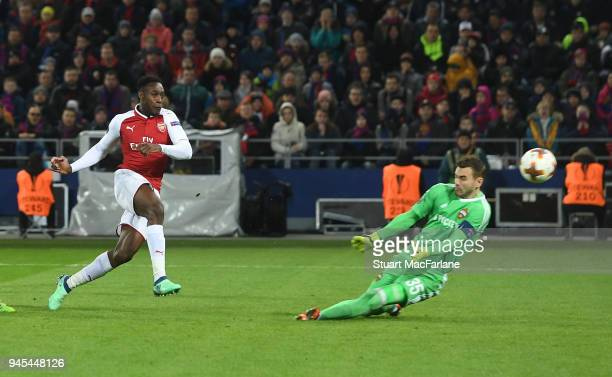 Danny Welbeck shoots past CSKA goalkeeper Igor Akinfeev to score for Arsenal during the UEFA Europa League quarter final leg two match between CSKA...